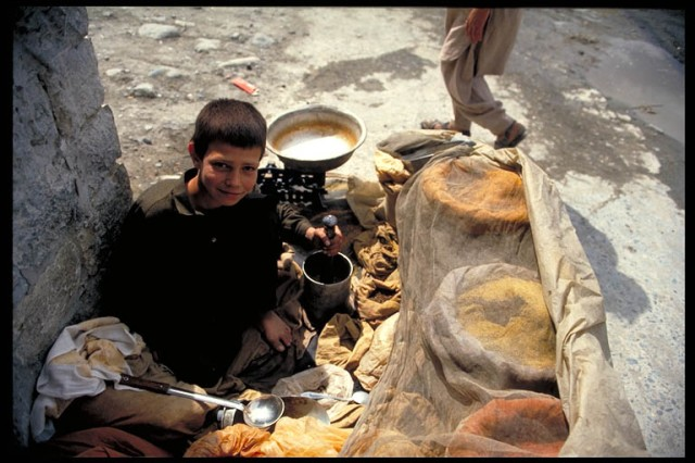 A child spice seller, Gilgit, Northern Areas, Pakistan. Photo © Mark Mauchline.
