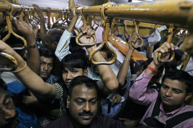 "Even inside the Western Railways carriage, the ""crush"" continues. Photo © Arko Datta / Reuters."